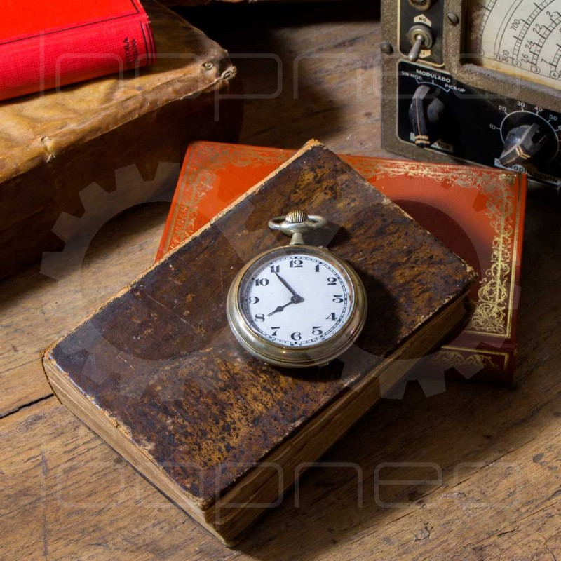 Pocket watch on book on books